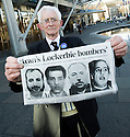 Dr Jim Swire, whose daughter Flora died when Pan Am Flight 103 crashed on the town of Lockerbie, Scotland, holds photographs of the men that he believes were responsible.     <br /> Dr Swire was at the Scottish Parliament<br /> to watch the premiere of Al Jazeera's, &quot;Lockerbie: What Really Happened?&quot;.