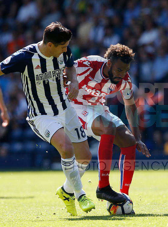 Gareth Barry of West Bromwich Albion tussles with Eric Maxim Choupomoting of Stoke City during the premier league match at the Hawthorn's Stadium, West Bromwich. Picture date 27th August 2017. Picture credit should read: Simon Bellis/Sportimage