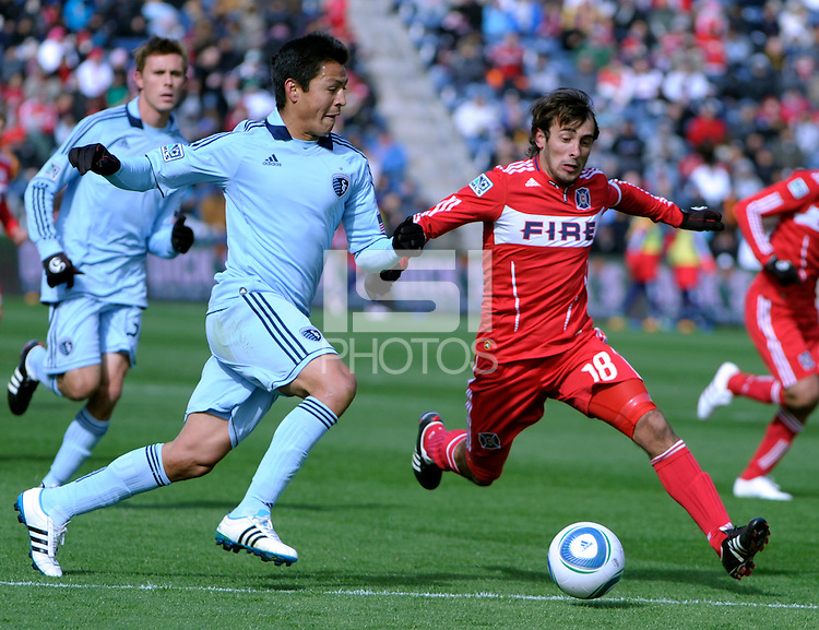 Sporting KC defender Roger Espinoza (15) and Chicago Fire forward Gaston Puerari (18) race for a loose ball. The Chicago Fire defeated Sporting KC 3-2 at Toyota Park in Bridgeview, IL on March 27, 2011.