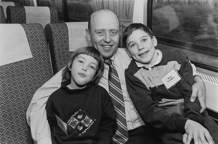 Rep. James B. Longley, R-Maine with daughter Sarah (6 and half years) and son Matt (10 years) in train travelling to Williamsburg, Virginia for a weekend on Jan. 16, 1995. (Photo by Laura Patterson/CQ Roll Call)