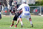 Corona Del Mar, CA 04/06/10 - Jared Welker (Danville/Monte Vista #14) and Dylan Salisbury (Corona Del Mar #21) in action during the Corona Del Mar-Danville/Monte Vista lacrosse game.