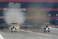 Jun. 19, 2011; Bristol, TN, USA: NHRA top fuel dragster driver Chris Karamesines (left) races alongside Antron Brown during eliminations at the Thunder Valley Nationals at Bristol Dragway. Mandatory Credit: Mark J. Rebilas-