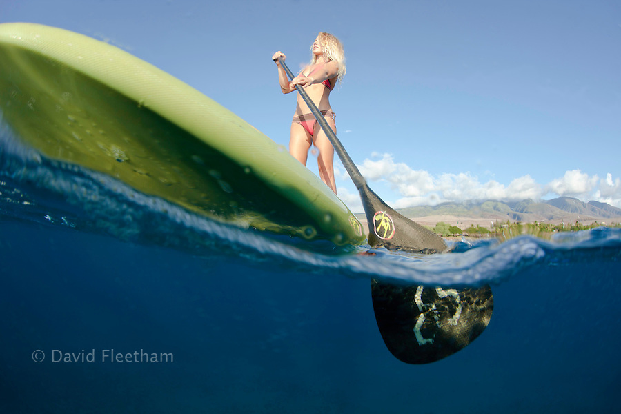 Surf instructor Tara Angioletti on a stand-up paddle board off Canoe Beach, Maui. Hawaii.  Image is model released.