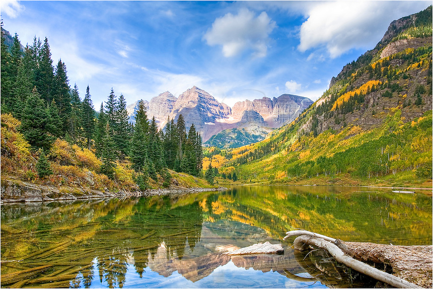 Each Autumn, photographers and beauty-seekers flock to capture in Colorado Images the Maroon Bells Wilderness Area near Aspen. With the right weather conditions, the aspen leaves turn a vibrant gold, and when the air is calm, the Maroon Bells are reflected in Maroon Lake. Get there early. On a calm morning in late September, hundreds of people will be lined up along the shore waiting for that perfect light.