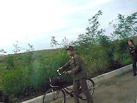 "Soldiers in the North korean country-side. North Korea is one of the last great dictatorships where, ""Our Dear Leader"" Kim-Jong-il and his father Kim Il-sung ""The Great Leader"" are worshipped and there is complete control of people who are constantly reminded of the evil deeds of the the west and USA."