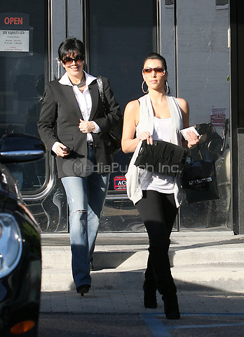 LOS ANGLES - CA - DECEMBER 10: Actress Kim Kardashian and her mom Kris Kardashian-Jenner out out shopping at a jewelry store.   on December 10, 2008 in Los Angeles, California<br /> <br /> <br /> People:  Kim Kardashian, Kris Kardashian-Jenner <br /> <br /> Transmission Ref:  MNC<br /> <br /> Hoo-Me.com/ MediaPunch