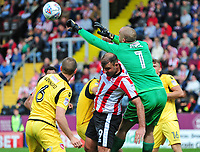 Morecambe's Barry Roche gets above Lincoln City's Matt Rhead to punch clear<br /> <br /> Photographer Andrew Vaughan/CameraSport<br /> <br /> The EFL Sky Bet League Two - Lincoln City v Morecambe - Saturday August 12th 2017 - Sincil Bank - Lincoln<br /> <br /> World Copyright &copy; 2017 CameraSport. All rights reserved. 43 Linden Ave. Countesthorpe. Leicester. England. LE8 5PG - Tel: +44 (0) 116 277 4147 - admin@camerasport.com - www.camerasport.com