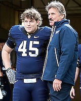 Pitt defensive lineman Tyler Tkach is greeted by head coach Dave Wannstedt on Senior Day. The WVU Mountaineers defeated the Pitt Panthers 35-10 at Heinz Field, Pittsburgh, Pennsylvania on November 26, 2010.