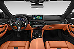 Stock photo of straight dashboard view of a 2018 BMW M5 Base 4 Door Sedan