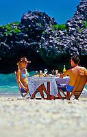 Honeymoon couple a picnic lunch on a deserted island (Nooki Nooki Island) near Vatulele Island Resort, Fiji Islands