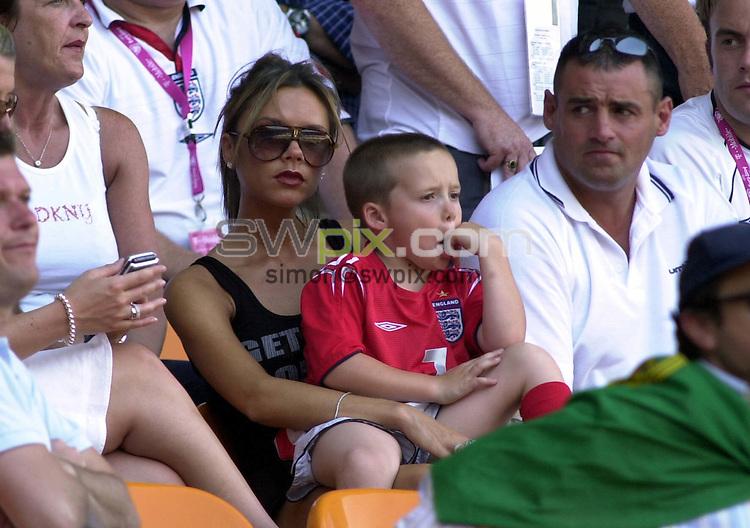 PIX: David Winter/SWpix.com. Football. Euro 2004. Group B: Englan v Switzerland, Cidade de Coimbra, Coimbra, 17th June 2004...COPYRIGHT PICTURE>> SIMON WILKINSON>>0870 092 0092>>..Victoria Beckham and son Brooklyn