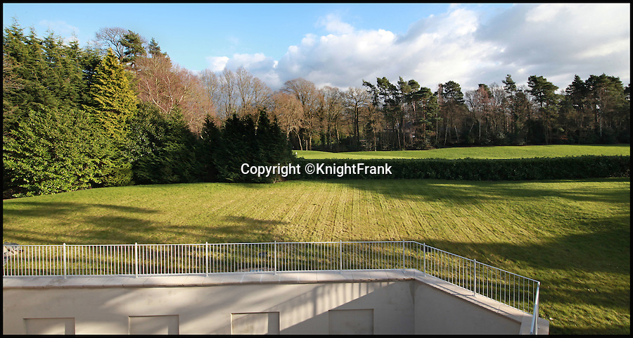 BNPS.co.uk (01202 558833)<br /> Pic: KnightFrank/BNPS<br /> <br /> Bolthole-in-one!<br /> <br /> Terrace view over the 17th green.<br /> <br /> Golf fans will be green with envy - This brand new Palladian style pad comes with a fantastic view of the 17th green at exclusive Wentworth golf club in Surrey.<br /> <br /> But despite the &pound;6.75 million price tag you will still have to pass muster with the members and stump up a &pound;125,000 joining fee to become part of the world famous club.<br /> <br /> Greenside is part of the Wentworth Estate, one of the most expensive private estates in the country, which has the Wentworth Golf Club at its heart.<br /> <br /> The lucky buyer of this house can watch the world's best golfers battle it out for the European Tour's PGA Championship from the balcony overlooking the 17th green of the iconic West Course.<br /> <br /> The newly-built five-bedroom home, on the market with Knight Frank, has everything you could need, including an indoor swimming pool complex with a sauna and a spa.