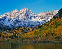 White River National Forest, CO: First light on snow dusted Maroon Peaks with fall colored aspens in the Maroon Bells-Snowmass Wilderness