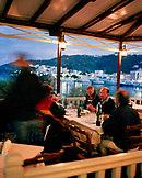 GREECE, Patmos, Skala, Dodecanese Island, guests dine on an outdoor patio at Taverna Tzivaeri