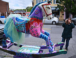 "Ginny Christensen of Saugerties, viewing, ""Seahorse"" by artist, Heather I. Martin, one of the 35 Artist painted Rocking Horses on display around Saugerties, NY as part of the Chamber of Commerce sponsored Art in the Village Project titled ""Rockin' Around Saugerties."" This photo taken on Friday, May 26, 2017. Photo by Jim Peppler. Copyright/Jim Peppler-2017."