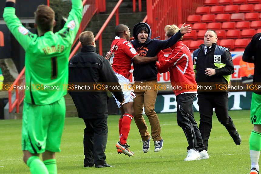 A combination of  Charlton players, coaching staff and stewards catch the pitch intruder at the final whistle - Charlton Athletic vs Wycombe Wanderers - nPower League One Football at the Valley, Charlton, London - 21/04/12 - MANDATORY CREDIT: Paul Dennis/TGSPHOTO - Self billing applies where appropriate - 0845 094 6026 - contact@tgsphoto.co.uk - NO UNPAID USE.