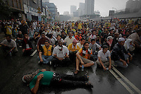 "Supporters of the ""Bersih"" electoral reform coalition sit on the road as police approach them during clashes in downtown Kuala Lumpur July 9, 2011. Malaysian police fired tear gas and detained more than 500 people in the capital on Saturday in a bid to prevent thousands of anti-government protesters from putting on a massive show of strength against Prime Minister Najib Razak.  REUTERS/Damir Sagolj (MALAYSIA)"