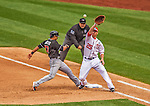 1 April 2013: Washington Nationals first baseman Adam LaRoche catches a pick-off move on Miami Marlins second baseman Donovan Solano as first base umpire Eric Cooper looks on during the Opening Day Game at Nationals Park in Washington, DC. The Nationals shut out the Marlins 2-0 to launch the 2013 season. Mandatory Credit: Ed Wolfstein Photo *** RAW (NEF) Image File Available ***
