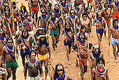 Altamira, Para State, Brazil. Group of Indians marching through the streets protesting against dam construction.