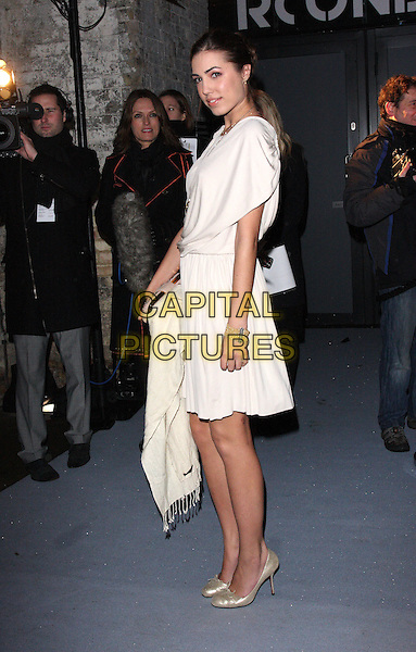 AMBER LE BON.Attending The Love Ball during London Fashion Week, the Roundhouse, Chalk Farm Road, London, England..February 23rd 2010.LFW arrivals full length beige white  ruched cream dress gold shoes white side LeBon.CAP/ROS.©Steve Ross/Capital Pictures.