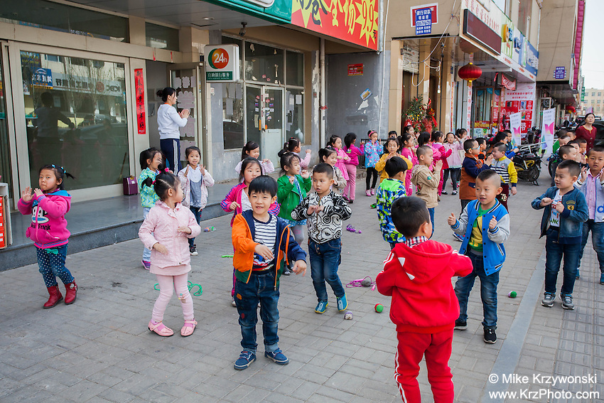 Children dancing during early morning exercise class at a preschool in Datong, China
