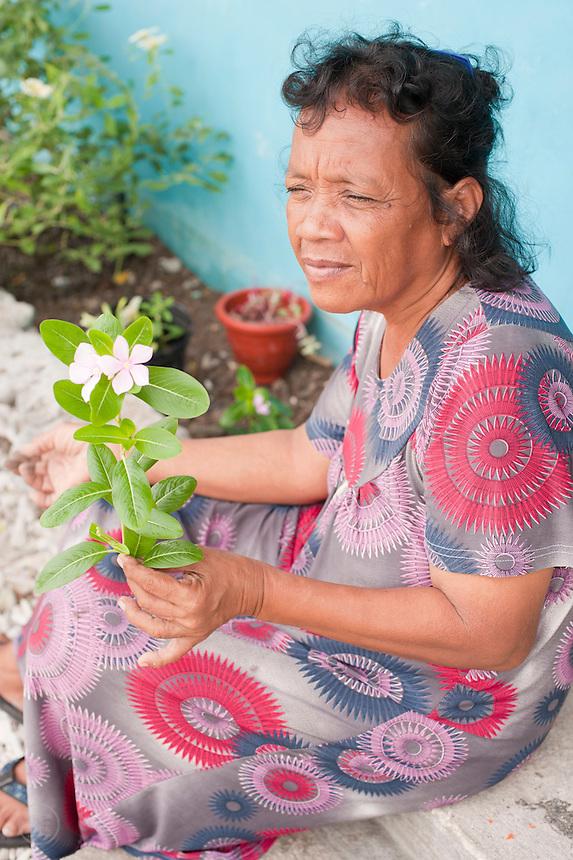 Portrait of a woman tending her flower garden on Jaluit Atoll, Marshall Islands