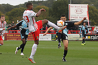 Jerome Okimo of Stevenage and Luke O'Nien of Wycombe Wanderers in action during the Sky Bet League 2 match between Stevenage and Wycombe Wanderers at the Lamex Stadium, Stevenage, England on 17 October 2015. Photo by PRiME Media Images.