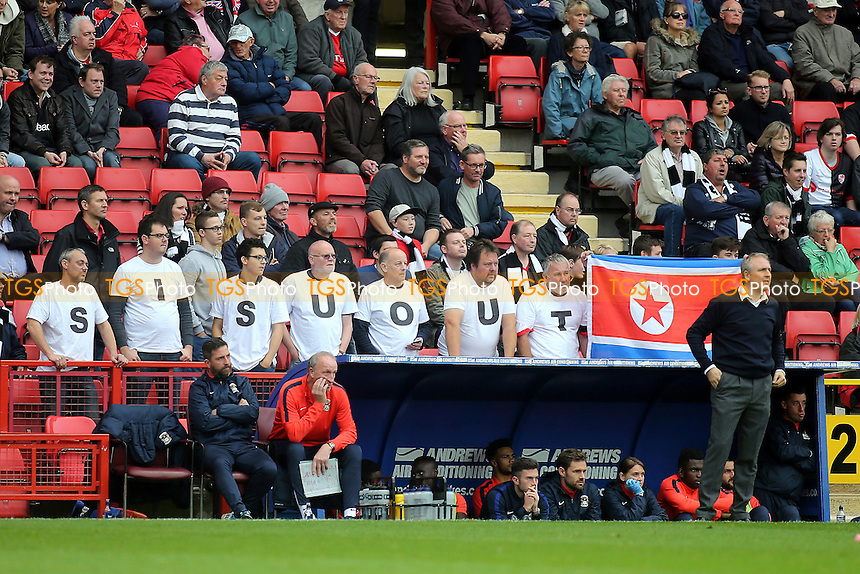 SISU Out is spelt out by some Coventry fans who stand up behind their Manager, Mark Venus to protest about the way their club is being run during Charlton Athletic vs Coventry City, Sky Bet EFL League 1 Football at The Valley on 15th October 2016