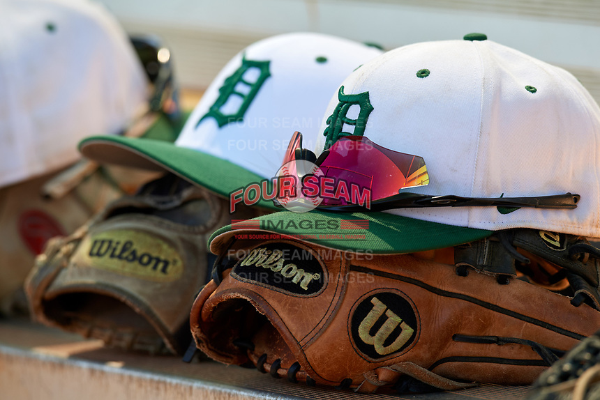 Dartmouth Big Green hats and gloves on the bench during a game against the Villanova Wildcats on March 3, 2018 at North Charlotte Regional Park in Port Charlotte, Florida.  Dartmouth defeated Villanova 12-7.  (Mike Janes/Four Seam Images)