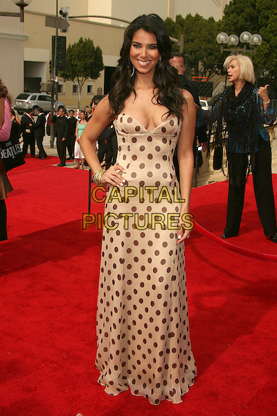 ROSELYN SANCHEZ.2007 NCLR ALMA Awards at the Pasadena Civic Center,.Pasadena, California, USA,.1st June 2007..full length  strapless cream and black polka dot dress hand on hip.CAP/ADM/BP.©Byron Purvis/AdMedia/Capital Pictures.