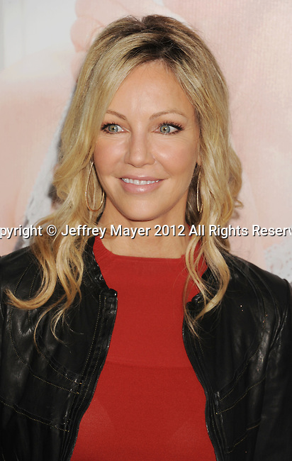 HOLLYWOOD, CA - DECEMBER 12: Heather Locklear  arrives at the 'This Is 40' - Los Angeles Premiere at Grauman's Chinese Theatre on December 12, 2012 in Hollywood, California.