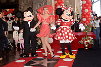 LOS ANGELES - JAN 22:  Mickey Mouse, Katy Perry, Minnie Mouse at the Minnie Mouse Star Ceremony on the Hollywood Walk of Fame on January 22, 2018 in Hollywood, CA