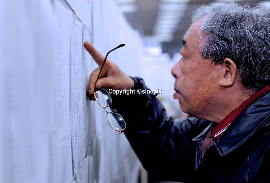 A man is looking at evacuation lists in the town-hall of Natori, near Sendai, Japan, hoping to see the names of missing relatives. The Tsunami devastated the entire pacifc coastline of Japan after the earthquake and tsunami devastated the area Sendai, Japan. One of the biggest earthquakes ever recorded struck off the coast of Japan on 11 Mar 2011 had killed thousands of people. The death toll was expected to rise dramatically, with tens of thousands reported missing..14 Mar 2011.