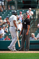 Columbus Clippers first baseman Jesus Aguilar (30) argues a call with umpire Roberto Ortiz during a game against the Rochester Red Wings on June 16, 2016 at Frontier Field in Rochester, New York.  Rochester defeated Columbus 6-2.  (Mike Janes/Four Seam Images)