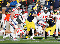 Ohio State Buckeyes wide receiver Philly Brown (10) dodges a tackle from Michigan Wolverines linebacker Brennen Beyer (97) in the fourth quarter of the college football game between the Ohio State Buckeyes and the Michigan Wolverines at Michigan Stadium in Columbus, Saturday afternoon, November 30, 2013. The Ohio State Buckeyes defeated the Michigan Wolverines 42 - 41. (The Columbus Dispatch / Eamon Queeney)