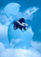 Surreal concept photo-illustration - a naked man seating inside an egg flying in the sky.