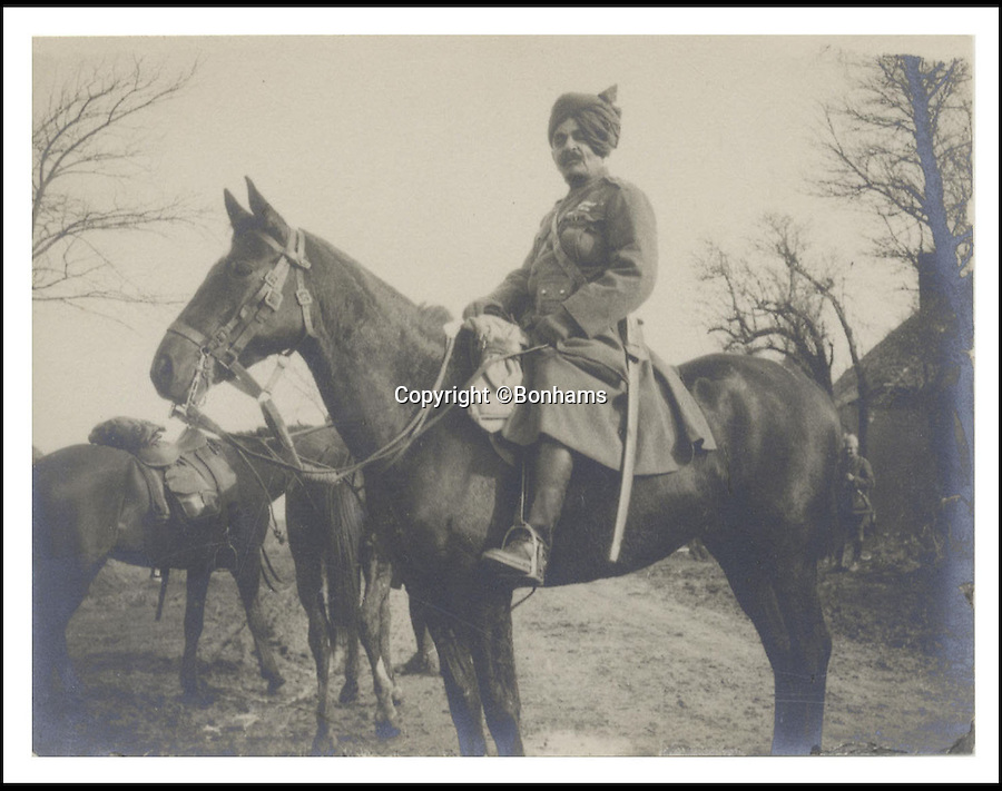 BNPS.co.uk (01202 558833)<br /> Pic: Bonhams/BNPS<br /> <br /> ***Please Use Full Byline***<br /> <br /> Sir Pertab Singh at a field day at the headquarters of the Indian Cavalry Corps, Chateau St. Andre, near Aire, February 1915. Image taken by Prince Edward VIII. <br /> <br /> <br /> <br /> A remarkable album of photographs taken by the future King Edward VIII during a 'sight seeing' tour of the Western Front 99 years ago has come to light.<br /> <br /> Edward, Prince of Wales, took his own camera with him on his morale-boosting visit to the front-line in France in 1915.<br /> <br /> The young Royal took scores of snaps which included a gang of captured German soldiers, shell holes, bomb damaged buildings and British troops practising throwing hand grenades.<br /> <br /> He also snapped numerous Army officers he met on the visit and posed for several photos as well.