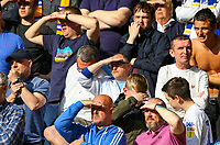 Leeds United fans shield their eyes from the sun during the first half<br /> <br /> Photographer Alex Dodd/CameraSport<br /> <br /> The EFL Sky Bet Championship Play-off  First Leg - Derby County v Leeds United - Thursday 9th May 2019 - Pride Park - Derby<br /> <br /> World Copyright © 2019 CameraSport. All rights reserved. 43 Linden Ave. Countesthorpe. Leicester. England. LE8 5PG - Tel: +44 (0) 116 277 4147 - admin@camerasport.com - www.camerasport.com