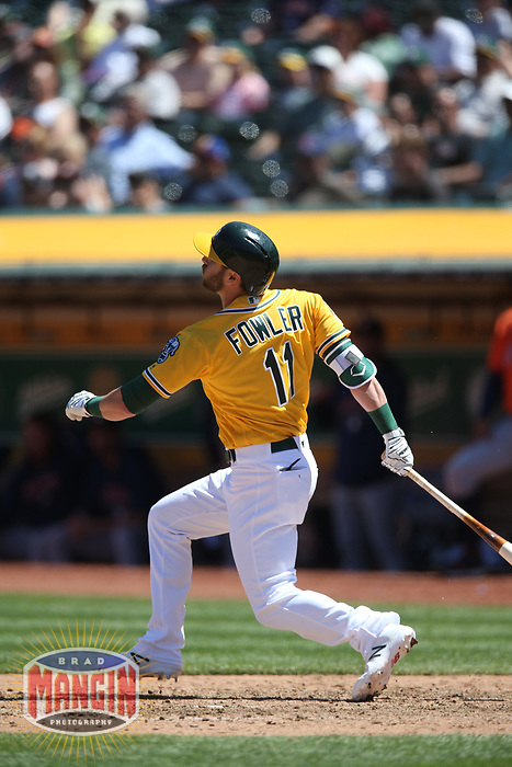 OAKLAND, CA - MAY 9:  Dustin Fowler #11 of the Oakland Athletics bats against the Houston Astros during the game at the Oakland Coliseum on Wednesday, May 9, 2018 in Oakland, California. (Photo by Brad Mangin)