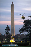 Marine One, with US President Donald J. Trump aboard, approaches a landing zone on the South Lawn of the White House  in Washington DC, USA, 02 December 2017. President Trump was returning from a fundraising trip to New York. Photo Credit: Shawn Thew/CNP/AdMedia