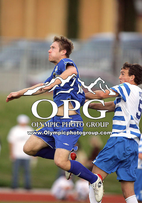 15 May 2010:   Kitsap Pumas defender #5 Taylor Hyde crashes in Tacoma Tide forward #20 Spencer Schomaker trying to get control of the ball.  The Kitsap Pumas defeated the Tacoma Tide 3-0 at Bremerton High School in Bremerton, WA.
