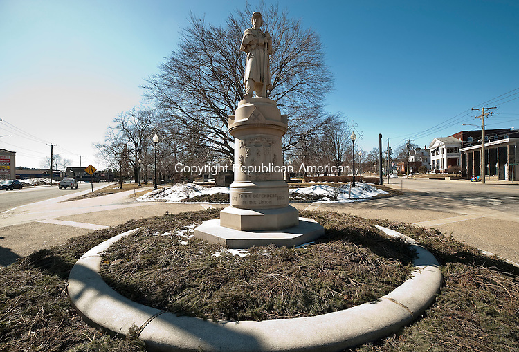 TORRINGTON ,  CT,  CT-041115JS50- The monument at Coe Park in Torrington, carries the original name of the community, Wolcottville. The figure, 16 feet of granite, first stood in front of City Hall but was moved to Coe Park in 1936 when the present City Hall building was constructed. Reports from the day said the Naugatuck Railroad ran an excursion train to the dedication ceremony, which was attended by 7,000 people. Jim Shannon Republican-American