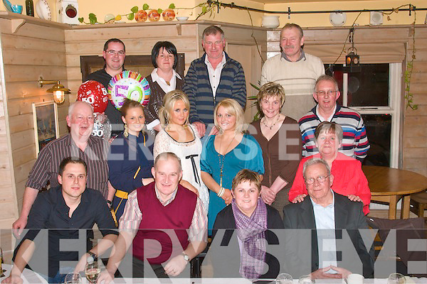 NIFTY FIFTY: Hanna O'Flaherty, Ardfert (seated 2nd left) who celebrated her 50th birthday last Saturday night in Stokers Lodge, Tralee surrounded by her family. Front l-r: Ben Veseli, Michael McCarthy, Hanna O'Flaherty and Dan Foley. Middle l-r: Pa Riordan, Triona Griffin, Emily Curran, Theresa O'Flaherty, Kathleen Weir, Ann-marie McCarthy and Ernie O'Flaherty. Back l-r: Declan McCarthy, Margaret Fitzgerald, John Hammel and Jim Costello.