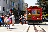 USA, California, San Francisco, a trolly stops and drops off passengers at the intersection of Lombard and Hyde streets