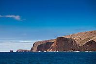 ragged sea cliff and Pu'u Pehe rock aka Sweetheart Rock in distance, Menele Bay, South Lāna'i, Lāna'i aka Pineapple Island because of its past as an island-wide pineapple plantation of Dole, the sixth-largest island of the Hawaiian Islands, Hawaii, USA, Pacific Ocean