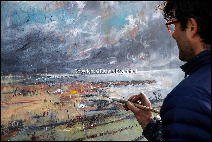 BNPS.co.uk (01202 558833)<br /> Pic: RichardBroomhall/BNPS<br /> <br /> Artist in Residence...Garratt in his element, at work on his Rhoscolyn Bay canvas.<br /> <br /> Artist Anthony Garratt is giving a whole new meaning to landscape painting - his incredible pieces aren't just of the landscape, they're in it too.<br /> <br /> The 35-year-old painter from Bristol has created four canvasses on the island of Anglesey as part of a new outdoor art installation and the paintings will remain in the exact spot they were painted until October.<br /> <br /> Mr Garratt spent several days on each of the giant 8ft-wide scenes, which are exposed to the elements and can be enjoyed by walkers as well as art fans. <br /> <br /> The landscapes had to be created on marine board - a thick marine plywood treated with sealant and epoxy, like a boat - rather than normal canvas, coated with five layers of varnish afterwards and mounted on bespoke steel frames to ensure they survive any harsh outdoor conditions.