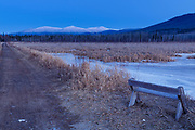 Northern Presidential Range just after sunset from the Presidential Range Rail Trail (Cohos Trail) at Pondicherry Wildlife Refuge in Jefferson, New Hampshire on a winter day. This trail utilizes the old railroad bed of the Boston & Maine Berlin Branch, which was abandoned and removed in the 1990s.