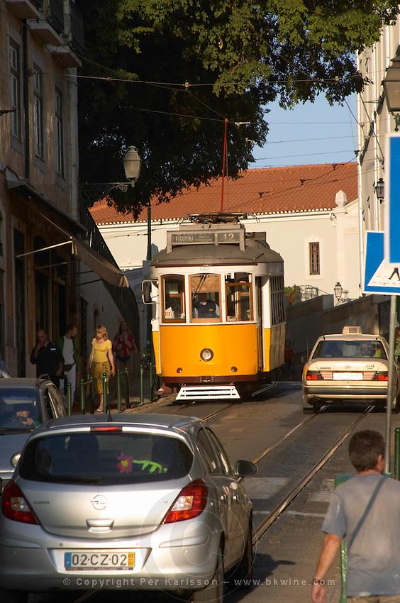 tram and cars alfama district lisbon portugal