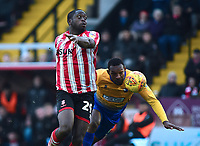 Lincoln City's John Akinde vies for possession with Mansfield Town's Krystian Pearce<br /> <br /> Photographer Andrew Vaughan/CameraSport<br /> <br /> The EFL Sky Bet League Two - Lincoln City v Mansfield Town - Saturday 24th November 2018 - Sincil Bank - Lincoln<br /> <br /> World Copyright &copy; 2018 CameraSport. All rights reserved. 43 Linden Ave. Countesthorpe. Leicester. England. LE8 5PG - Tel: +44 (0) 116 277 4147 - admin@camerasport.com - www.camerasport.com