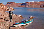 Jacque Miniuk soaks in her beautiful surroundings in Good Hope Bay while taking an on-shore break on Lake Powell in the Glen Canyon National Recreation Area, Utah